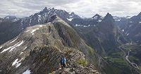 Fjella i Romsdal er vakre - og ville! En ypperlig anledning for deg som er tilreisende er å delta på Norsk Fjellfestival, som går av stabelen hvert år i juli. Kanskje treffer du noen troll også?