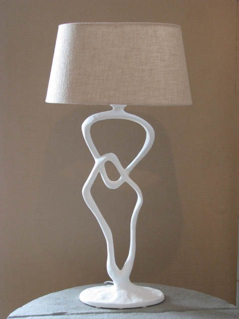 An original table lamp by Trevor Opperman entitled: 'Double Link Lamp (White)'. Cast Beaten Aluminium. For more please visit www.finearts.co.za