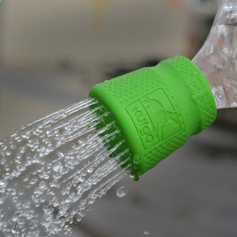 Camping Shower - Mud Dog Travel Shower — Kurgo Products | Screw this food-grade silicone shower head onto a standard PET plastic soda bottle (from 16 oz. to 2 liter) to create a convenient, use-anywhere shower. Quickly, easily rinse off dirty paws or muddy gear after any outdoor adventure. Its ideal for hiking, camping, and trips to the dog park! Dishwasher safe.