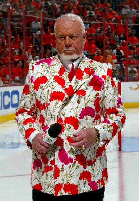 Don Cherry in jacket with pink and red carnations