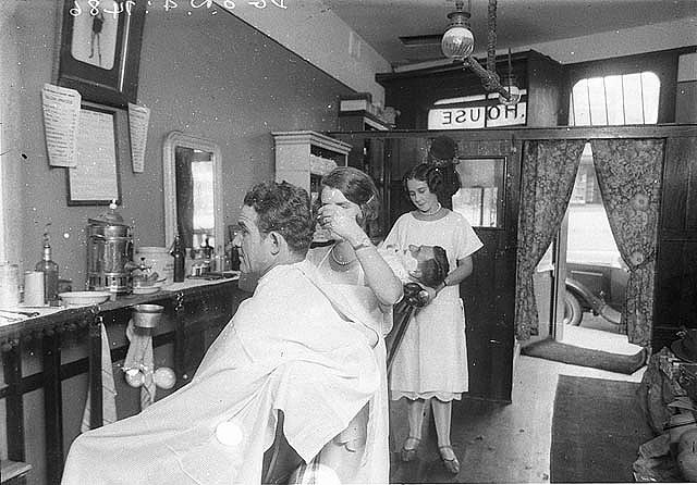 Two of the first female men's barbers, Miss Dolly House and her sister, c.1927 / photographed by Sam Hood (Australia)
