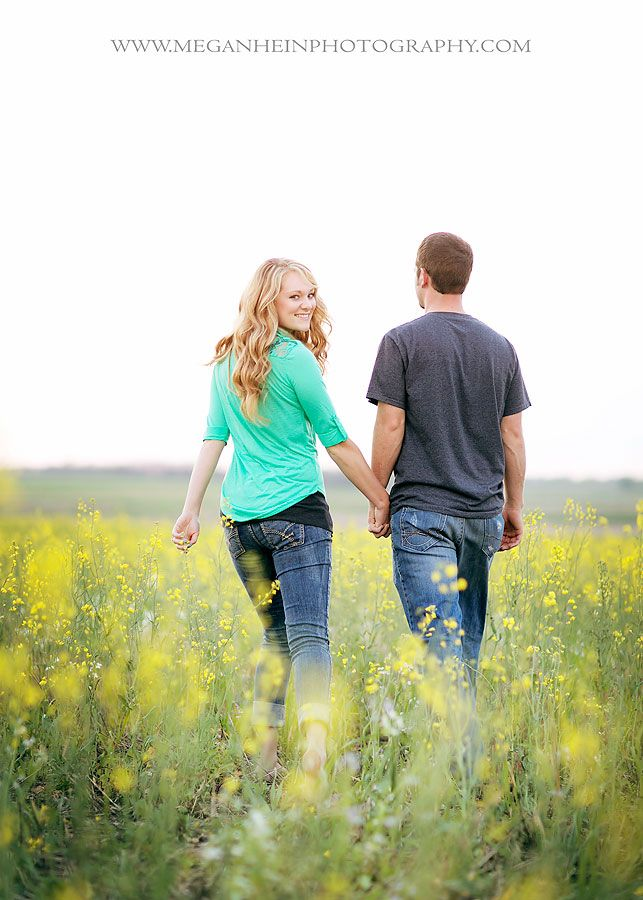 Couples and engagements photography have the couple walking and only one looking back