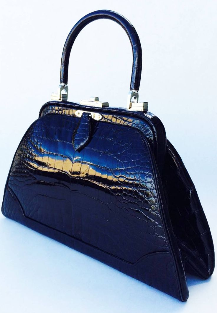 Judith Leiber Porosus Crocodile Handbag 1970s | From a collection of rare vintage handbags and purses at https://www.1stdibs.com/fashion/accessories/handbags-purses/