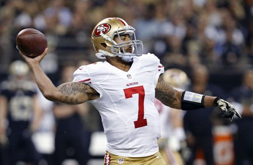 San Francisco 49ers quarterback Colin Kaepernick (7) passes in the first half of an NFL football gam... - (AP Photo/Jonathan Bachman
