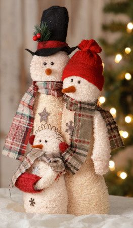 Family of three plush snowmen