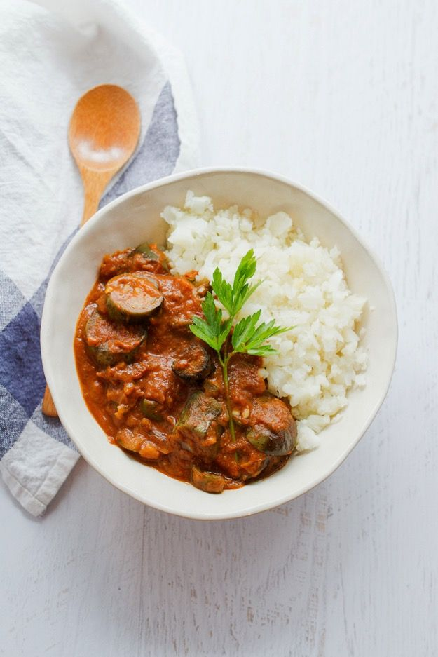 Eggplant and zucchini slow cooked in a creamy tomato sauce with Indian spices. Serve with cauliflower rice for a flavorful vegan and gluten-free meal!
