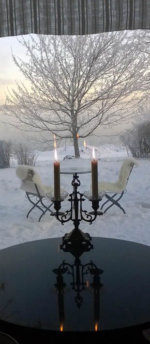 Snow and candle light in Samovarbar, December 2014 Café Samovarbar in the Suomenlinna Toy Museum Helsinki