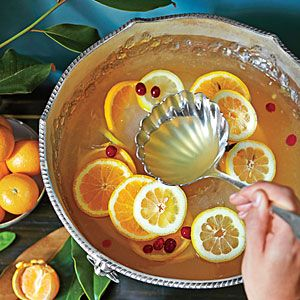 Montgomery Punch from the Junior League of Montgomery, Alabama | Southern Living          :::::::::::::::::::::::::::::::::::::::::::::::::::: 2 cups fresh lemon juice, 1 1/2 cups sugar, 1 cup brandy, Ice Ring, 2 (750-milliliter) bottles chilled sparkling wine, 1 (375-milliliter) bottle chilled dessert wine (such as Sauternes) Garnishes: orange slices, lemon slices, cranberries