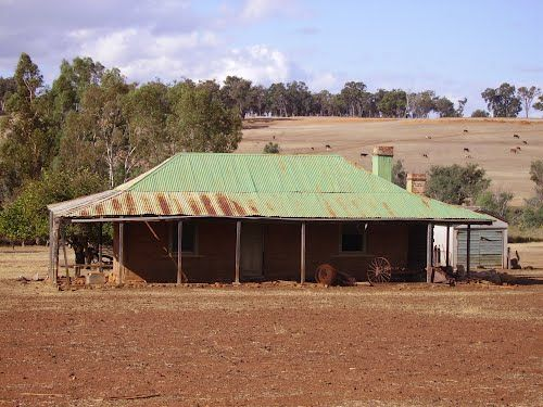 Old Australian Farmhouse, only straw bale with floor legnth windows for solar gain