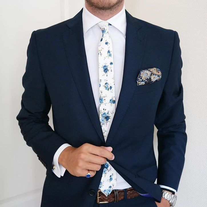 Our brand ambassador Johann Christian featuring our July floral tie from Dazi USA along with nice paisley pocket square and navy blue suit.