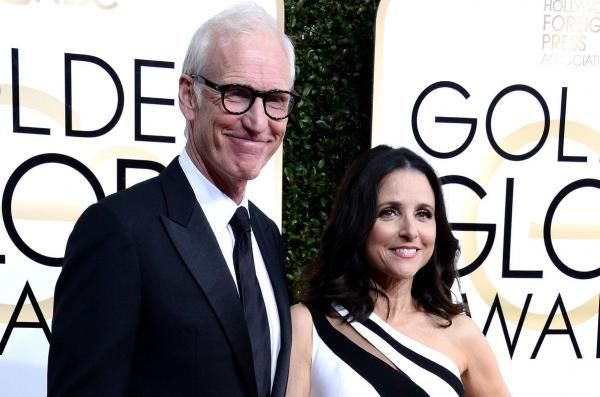 Julia Louis-Dreyfus shared a holiday photo on Instagram Wednesday of herself kissing her husband Brad Hall under a mistletoe.