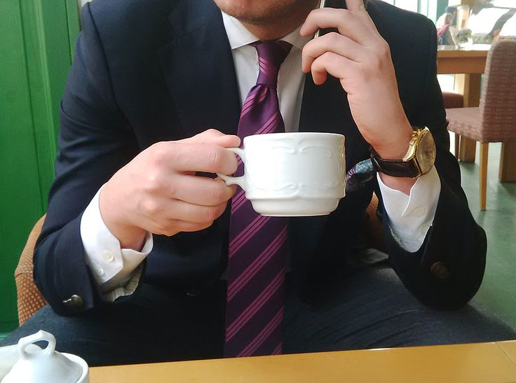 Cristian wearing a Corneliani Blazer + Invicta watch + a cup of mint tea!
