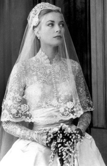 1956 - Grace Kelly's bridal gown, created by Helen Rose - designed with 25 yards of silk peau de soie, 100 yards of silk net, museum purchased 125-year-old rose point lace, and thousands of tiny pearls were sewn on her veil: