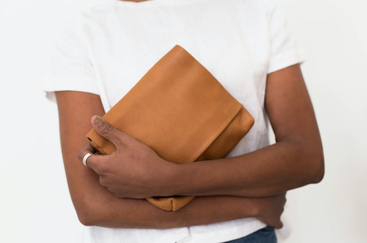 MOMO Large Clutch Tan     Minimalistic, beautiful soft leather a classic clutch with plenty of room for all your essentials. The Momo features magnetic closure and an interior zip. The Momo clutch adds a touch of luxury and understated style to any outfit, day or night.