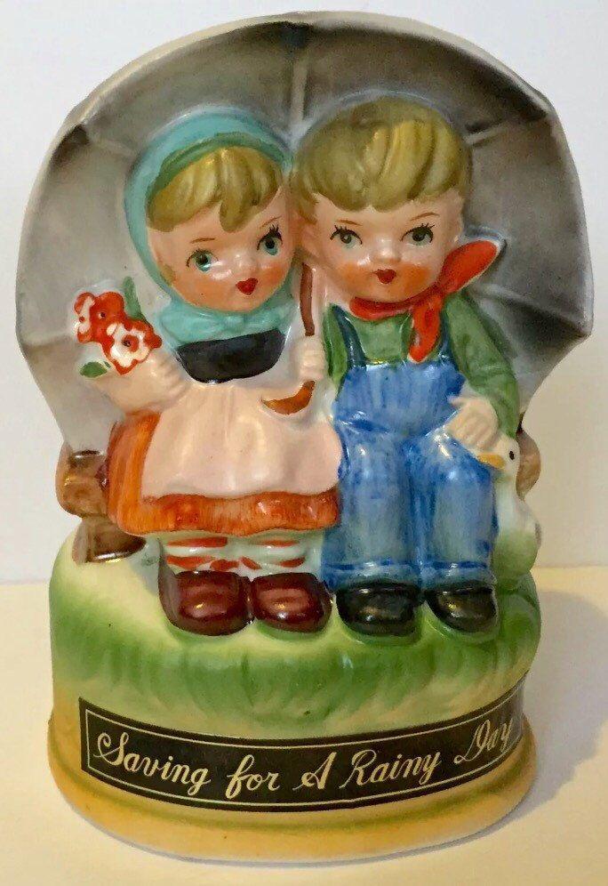 Rainy day savings bank, hummel style music box, musical bank, Raindrops keep falling on my head, vintage bank, vintage music box, coin bank by SweetVintageRoad on Etsy https://www.etsy.com/listing/491117769/rainy-day-savings-bank-hummel-style