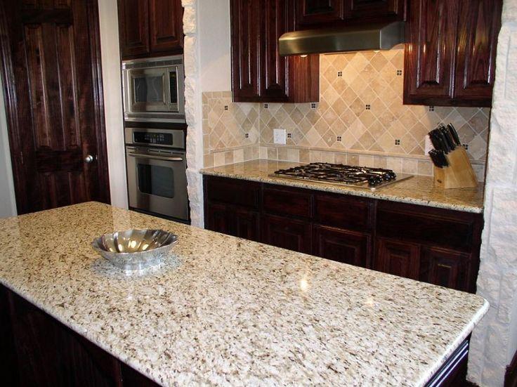 Giallo Ornamental Granite with bottom border backsplash
