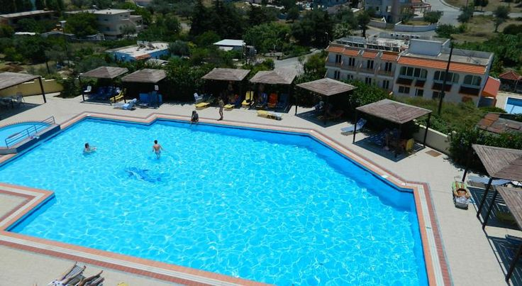 Telhinis Hotel Faliraki Located in the seaside resort of Faliraki, Telhinis Hotel offers a large swimming pool and rooms with a private balcony. Free WiFi is available in the entire property. It offers free on-site parking.