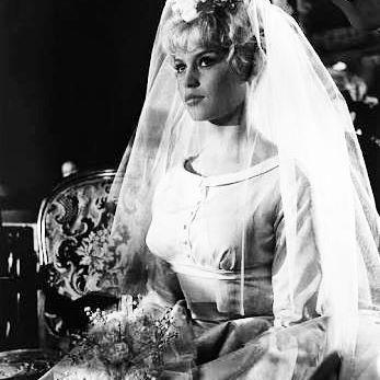 "The last wedding dress session  Brigitte Bardot in ""Une Parisienne"". ° The Dress: A waist-emphasizing empire silhouette designed by Jacques Esterel. #brigittebardot #brigitte #bardot #bb #uneparisienne #umaparisiense #laparisienne #jacquesesterel #vintage #bride #bridal #dress #wedding #weddingdress #mariee #mariée #oprincipeeaparisiense"