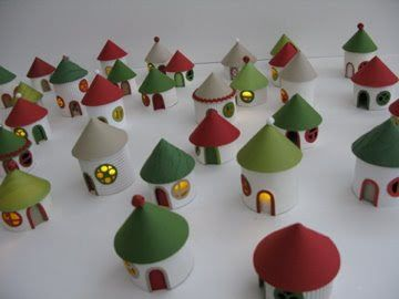 This would make a fantastic Advent calendar...Christmas Village From Toilet Paper Rolls