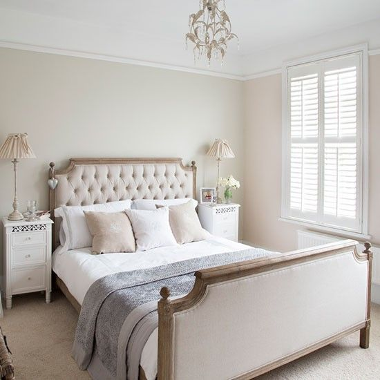 A beautiful upholstered bed is the main focus of the bedroom. The muted colour palette on the walls and floor blends in with the neutral upholstery.