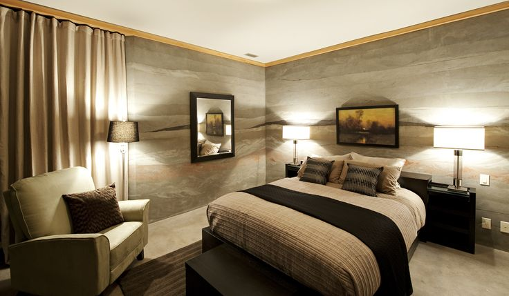 Master bedroom exhibits the warmth of the Rammed Earth Walls and the polished concrete floors.