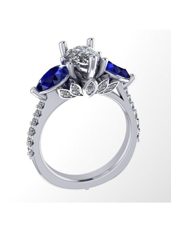 this pear shape engagement ring with ceylon sapphires set on both sides of the center stone - Wedding Rings Houston