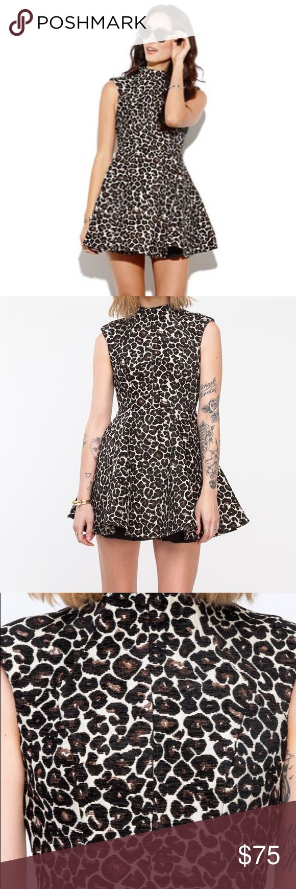 """Cameo Luck Now Dress, Brand New and never worn! NWOT, A textured, jacquard woven dress from Cameo in an exclusive leopard pattern. Features a structured body. Size small best fits size 2,4. •Sleeveless jacquard dress  •Flared skirt •High neckline •YKK back zip closure •Fully lined •45% Cotton, 55% Polyester •100% Polyester lining •Wash cold inside out, air dry.                   15.5"""" bust 12"""" waist 30.5"""" shoulder to hem Measurements taken from size extra small Model wears size extra…"""
