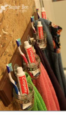 great way to organize a kid's bathroom - they each get their own hook and jar to hold supplies - perfect!