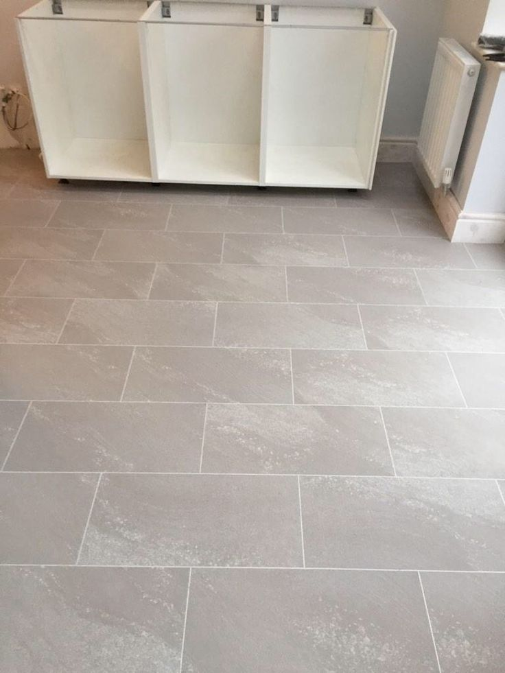 Polyflor Colonia Balmoral Grey Slate with an Ice Grout Strip