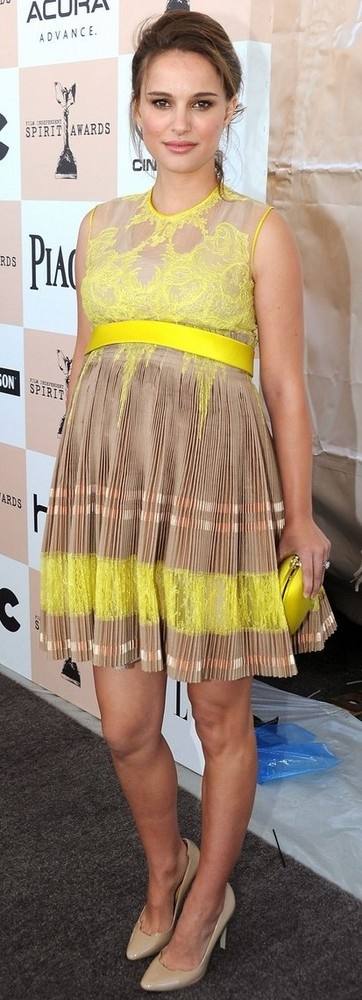 the lemon yellow empire waist dress is so cute...also love the bright clutch and nude pumps.