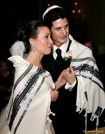 German tradition of covering the couple in a tallit (prayer shawl) during the ceremony.