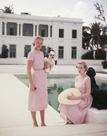 C.Z. Guest, in a pale pink sundress with her friend and poodle in Palm Beach, 1955
