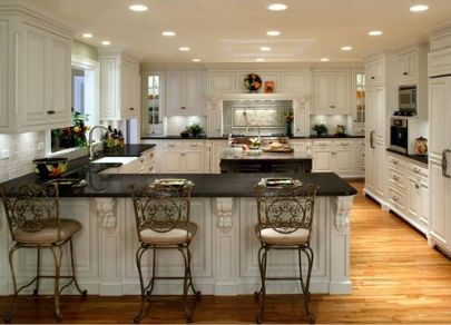White cabinets with granite countertops off white for Black country kitchen cabinets