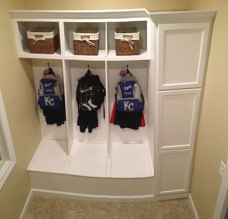 Custom Built Wood Cubbies In Our Laundry Room. Hidden Storage On The Right.  Each Section Of The Bench Has Hinges On It So Each Boy Has His Own Shoe Bin.