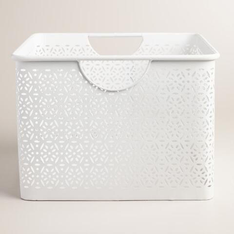 Lend a fresh look to the powder room or master bath with our crisp white storage bin, crafted of punched metal in a filigree design. Pair it with our medium-sized Mia bin or rolling cart to create even more stylish storage for towels and toiletries.