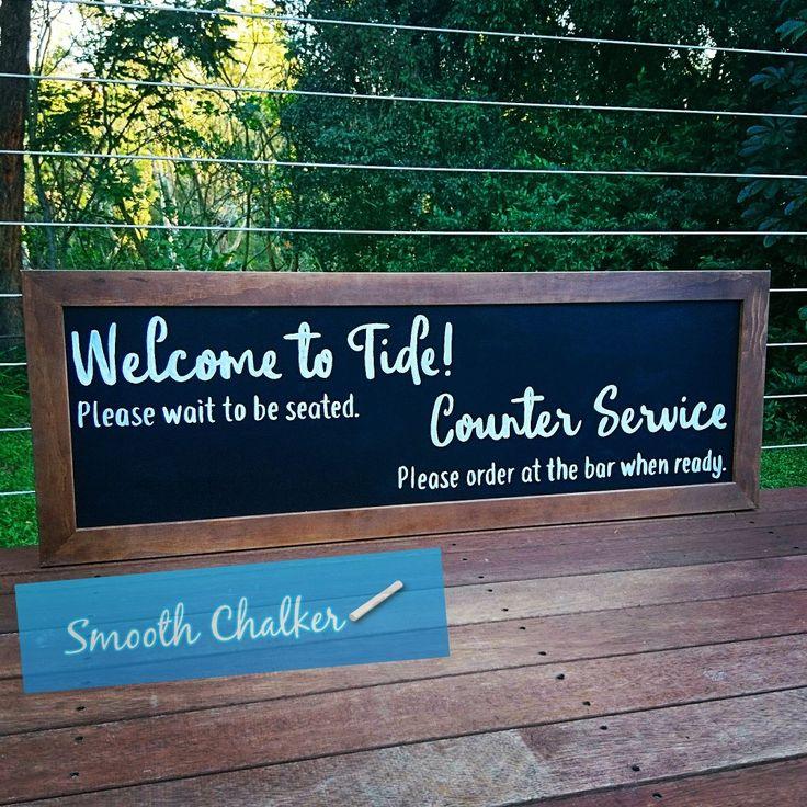 Chalkboard sign for Tide Wine Bar