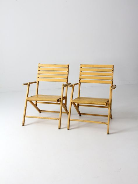 vintage slat wood folding chairs pair, yellow outdoor furniture by 86home on Etsy https://www.etsy.com/listing/193037795/vintage-slat-wood-folding-chairs-pair
