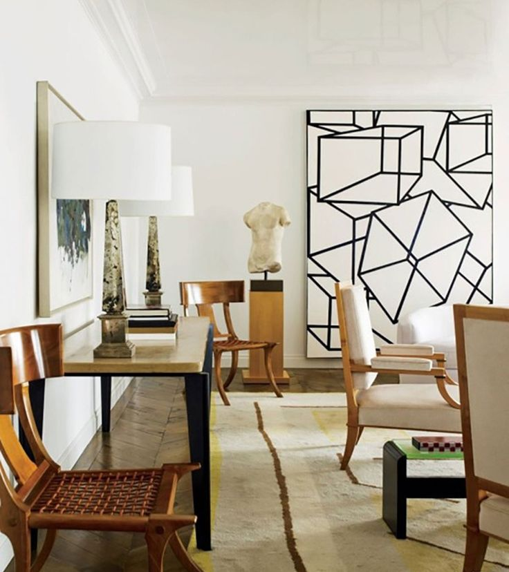 Now this is a statement. One gigantic geometric work of art on your wall can have a jaw-dropping effect. It makes an interior look arty and bold. A group of framed geometric forms will also do the trick.
