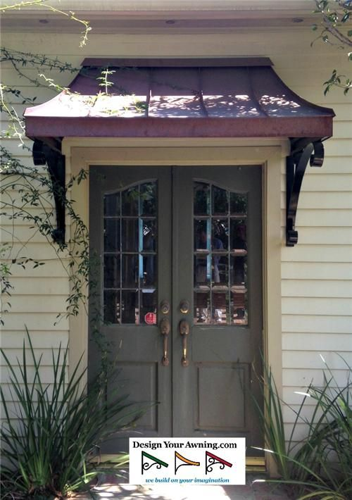 awnings on french doors | The metal Juliet awning over front door in Zionsville,IN (Bronze) 4 ...