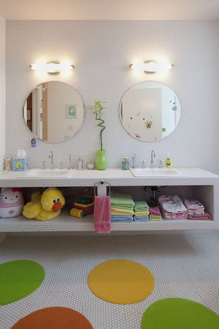 This brightly-colored bathroom is perfect for kids. We love the spotted mats and storage space.