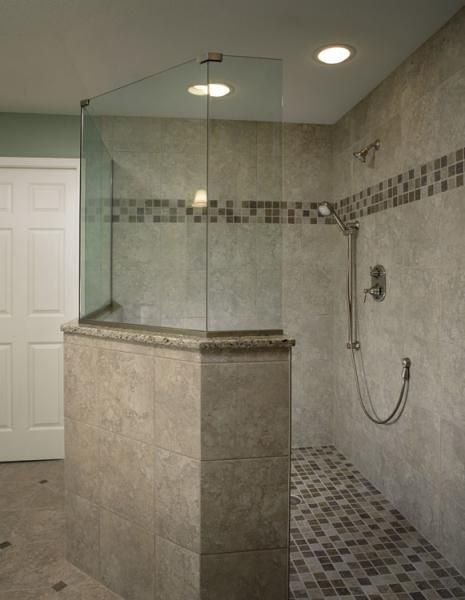 Large Walk In Shower Tile Floor And Walls With Glass Enclosure And Mosaic Tile Floor And Mosaic Tile Border Bathrooms By Design Connection Inc