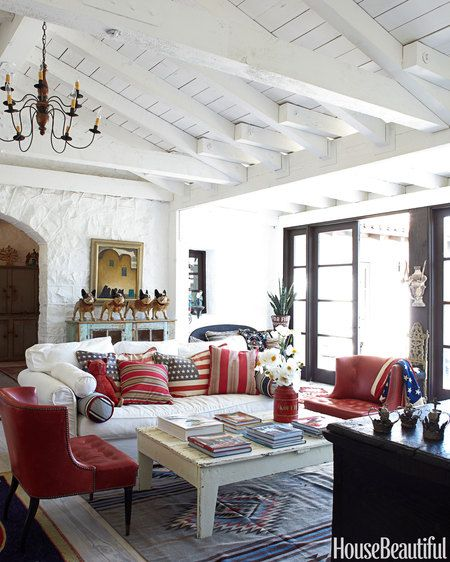 This living room in a farmhouse in Ojai, California, is filled with American flag accessories.
