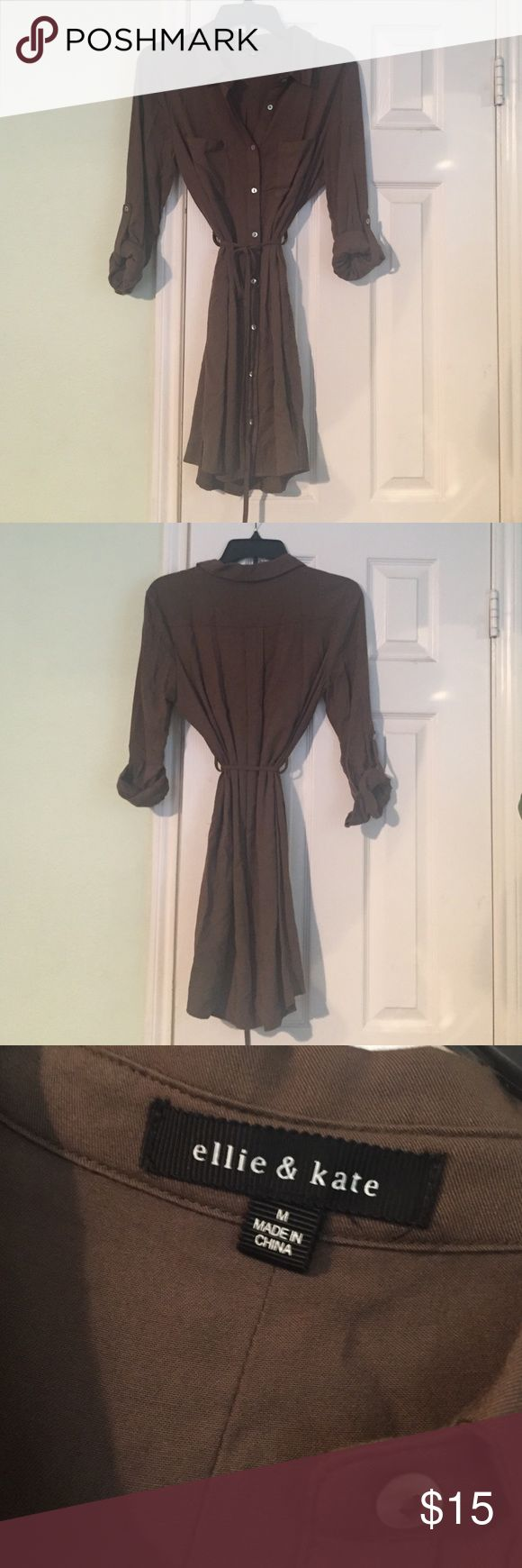 Olive green shirt dress with adjustable tie waist Gorgeous shirt dress in olive green! Only selling because it's too big on me! Has an adjustable tie waist detail and sleeves that can be rolled up and buttoned. Never been worn! Ellie and Kate Dresses Mini