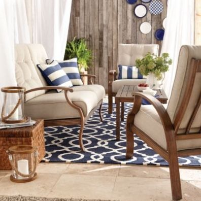 Bring the beach to your patio with taupe cushions and nautical throw pillows.