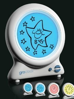 """Stay in bed until you see the sun!"" This clock displays a sleepy star during nighttime hours, and a cheerful sun during the day. Parents choose what time the sun appears, so the child knows when it's ok to get out of bed."