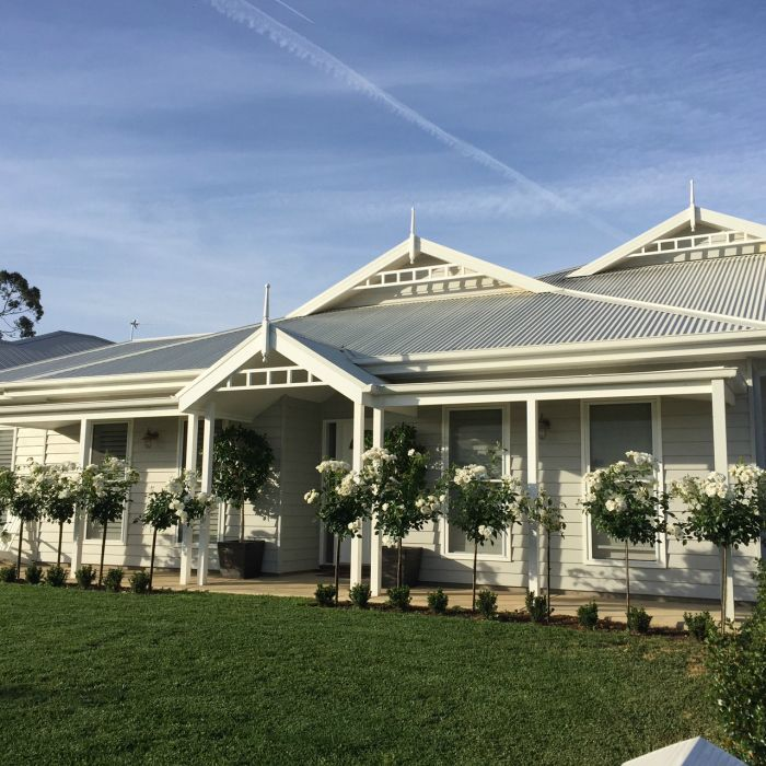 Weatherboards: shale grey, roof/gutter/fascia: surfmist and trimmings - white. (window frames, shutters, posts and fretwork)