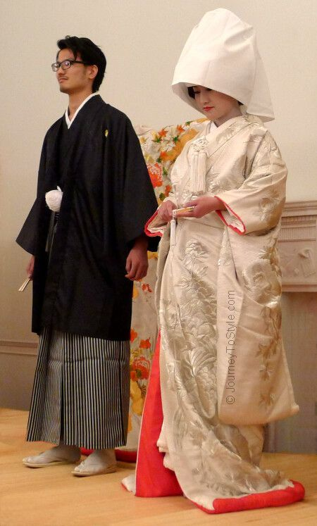 The traditional Japanese wedding costumes of 'montsuki' kimono, hakama and haori (for the groom), and white 'shiromuku uchikake' and kimono (for the bride). Typically worn for a Shinto wedding ceremony.
