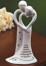 "Irish Wedding Bell Figure  $36.95   High-fired ceramic bell is trimmed in green and shiny gold. Has a ceramic clapper. Boxed. 7"" tall. Also can be used as a wedding cake topper! Text reads, ""Two hearts, two lives are joined in love with blessings from our God above."" Also ""Joined in Love"" on the arms."