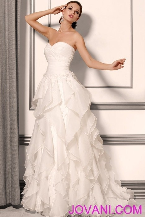 Ruffled organza wedding dress with embellished lace,