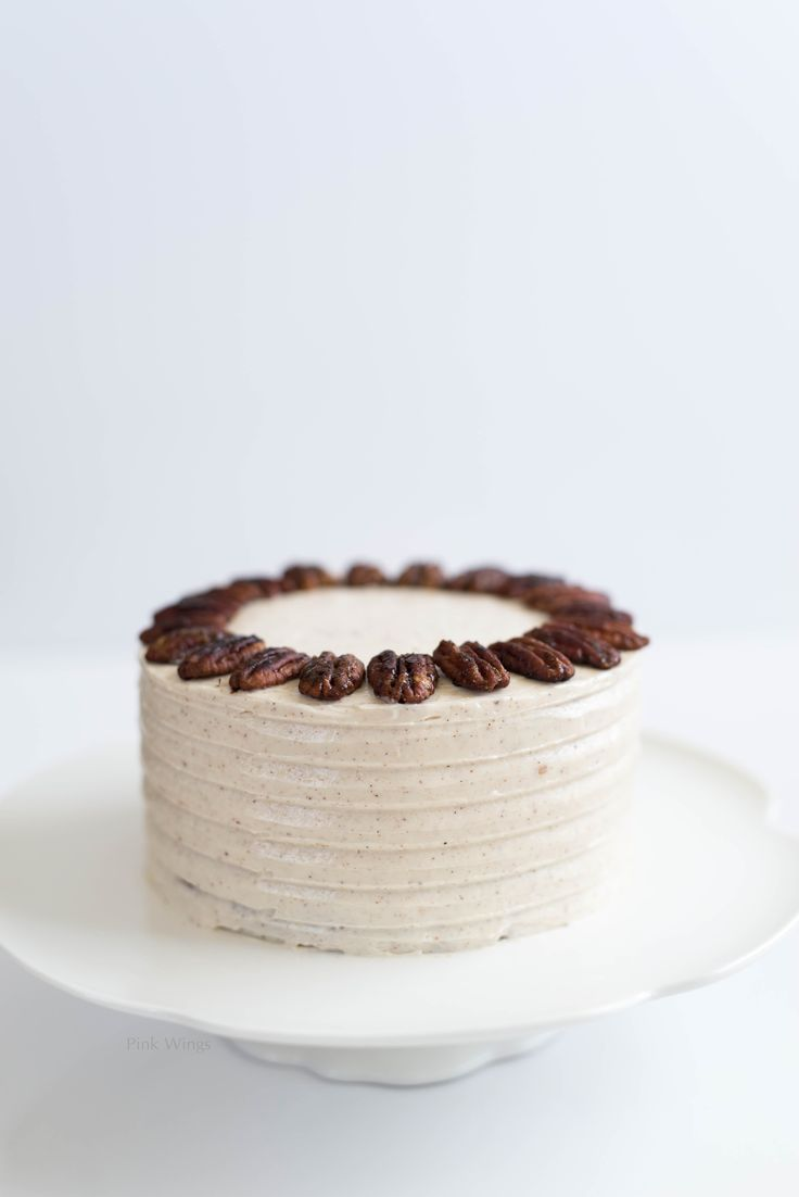 spiced pear cake with cinnamon nutmeg buttercream and candied pecans